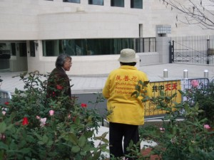 Falun Dafa Activists Arrange Protest Signs Across from PRC Embassy