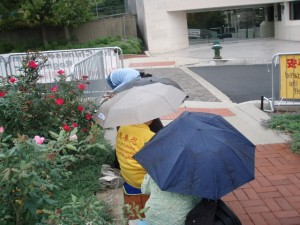 Falun Dafa Protesters Continue in the Rain at the DC PRC Embassy