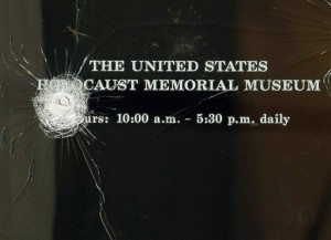 Bullet strikes are seen in one of the doors to the United States Holocaust Memorial Museum after a shooting left a security officer dead and the gunman wounded in Washington Thursday, June 11, 2009.(AP Photo/Alex Brandon)