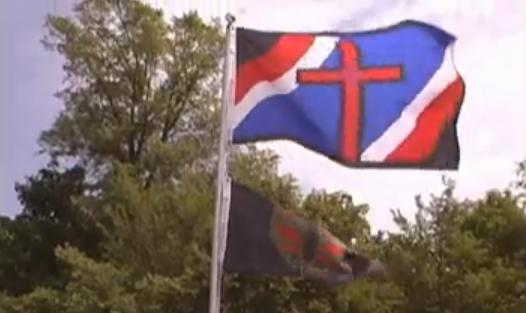Another Hutaree Flag Over Milita Training Area (Photo: YouTube)