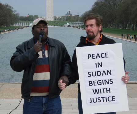 Mohamed Yahya and Jeffrey Imm Grasp Hands in Solidarity Together on Lincoln Memorial Calling for Justice and Human Rights in Darfur