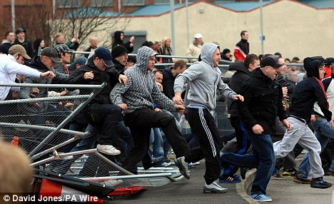 Clashes: English Defence League protesters break through barriers during a demonstration through the streets of Dudley  (Photo: Daily Mail/PA Wire - David Jones)