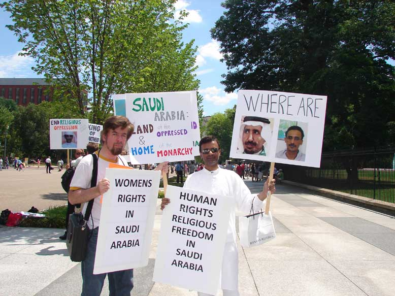 Muslim Mahdi Husain (Right) of the IIC and Christian Jeffrey Imm (Left) of R.E.A.L. Picket Together for Religious and Women's Freedom in Saudi Arabia