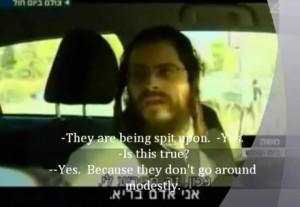 Local Man in Beit Shemesh Justifies Spitting On Little Girls (Photo Clip: YouTube / Channel 2)