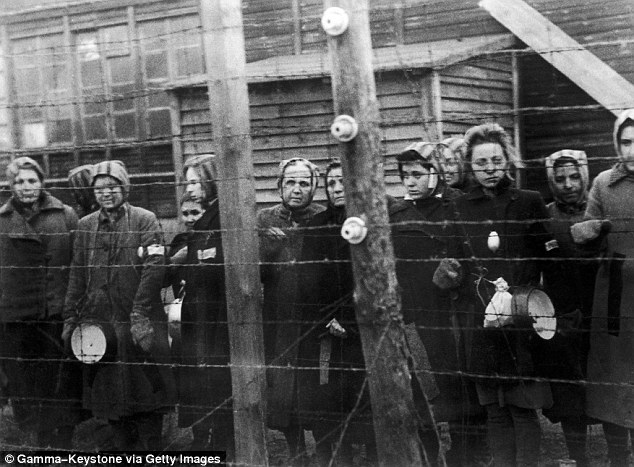 Prisoners at Ravensbruck concentration camp in Germany stand near barbed wire in 1945 (Source: Daily Mail/ Gamma-Keystone, Getty Images)