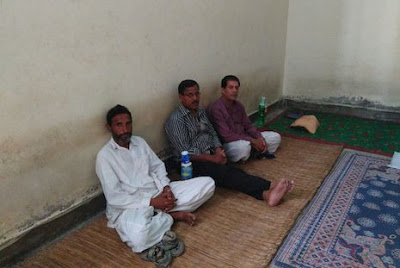 Pastor Aftab Masih Gill, Latif Masih and Shafqat Gill at a police station in Gujrat (Source: UCA News)