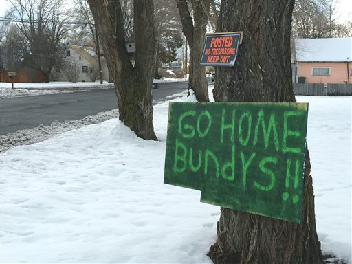 A sign tacked outside a Burns. Oregon, home reflects community sentiment that outsider terrorist group is not welcome (Source: Les ZaitzThe Oregonian via AP)